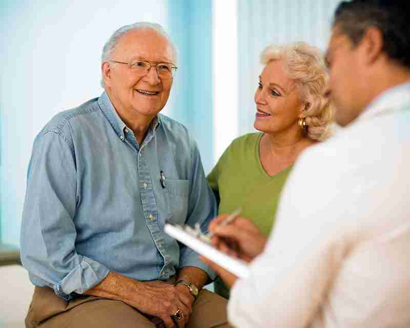 Senior couple talking with doctor